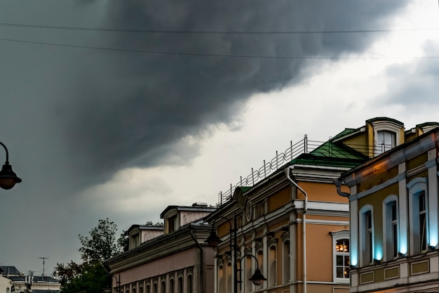 Heavy rain and massive clouds flying over the europe city rooftops Premium Photo