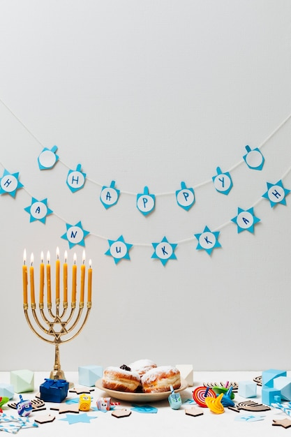 Hebrew menorah with sweets on a table Free Photo