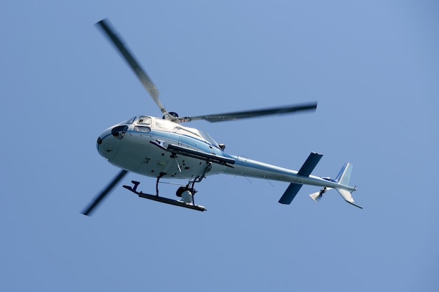 Helicopter flying over the blue sky Premium Photo