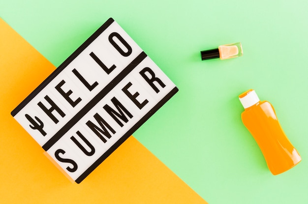 Hello summer text in frame and summer stuff Free Photo
