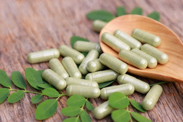 Herbal medicine powder with capsules  for healthy eating from many herbs, alternative supplement for good living Premium Photo
