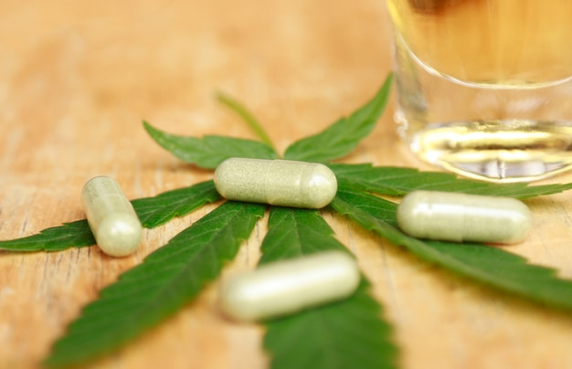 Herbal medicine with cannabis leaf for healthy remedy eating Premium Photo