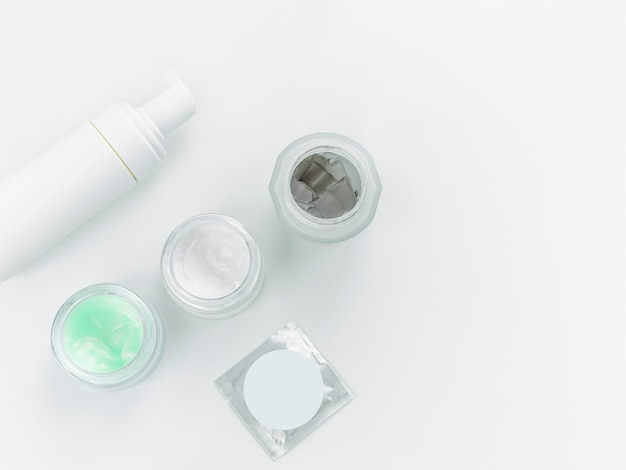 Herbal spa dermatology cosmetic hygienic cream with skincare product in glass jar on white background. Premium Photo