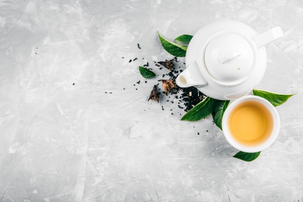 Herbal tea and a teapot on a concrete background Premium Photo