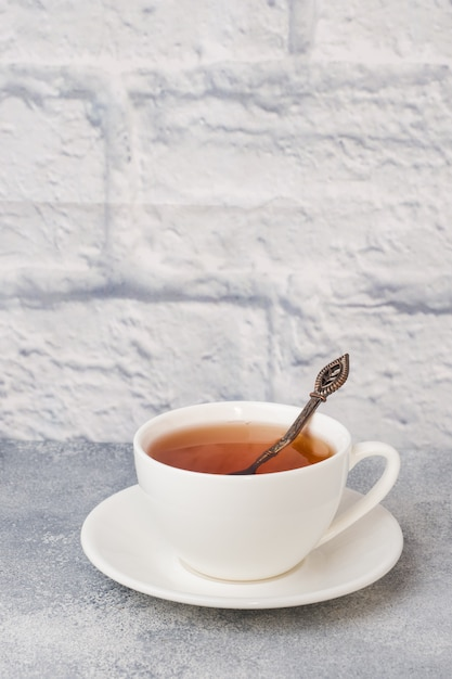 Herbal tea in a white cup. gray surface Premium Photo