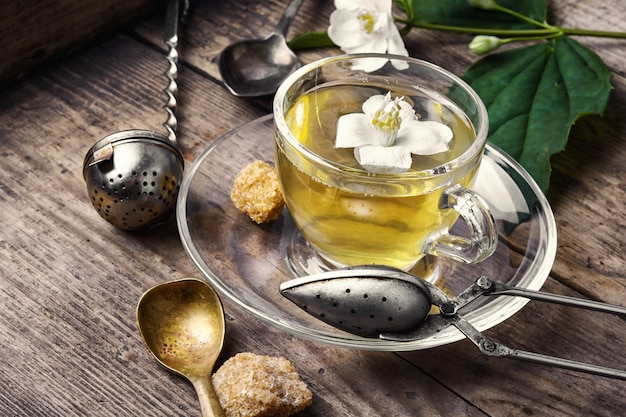 Herbal tea with jasmine flowers Premium Photo