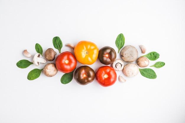 Herbs and mushrooms near tomatoes Free Photo