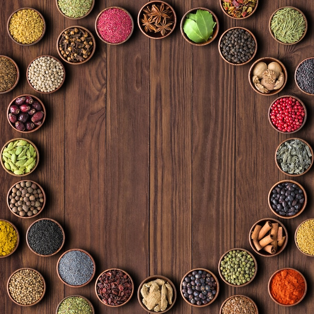 Herbs and spices over wooden table background. multicolored seas Premium Photo