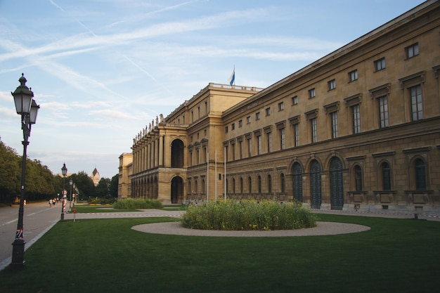 Hercules hall surrounded by greenery under the sunlight at daytime in munich in germany Free Photo