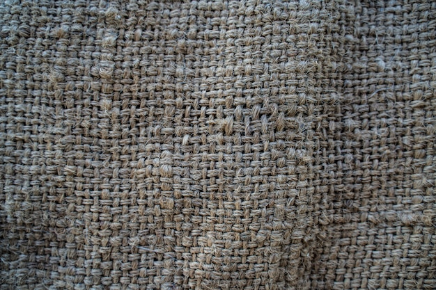 The hessian sackcloth woven texture pattern background in light cream yellow beige color Premium Photo