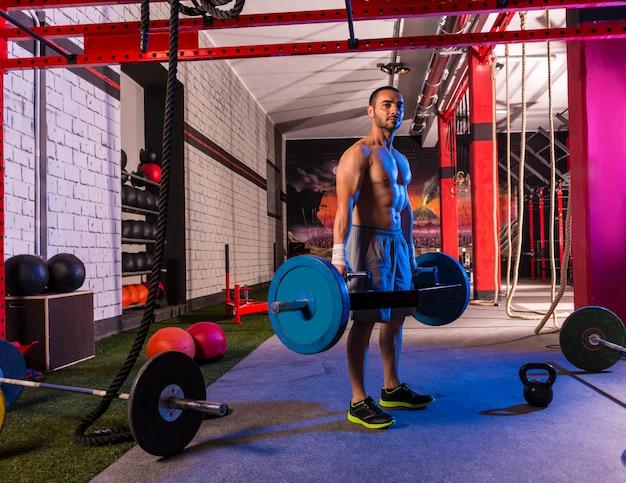 Hex dead lift shrug bar deadlifts man at gym Premium Photo