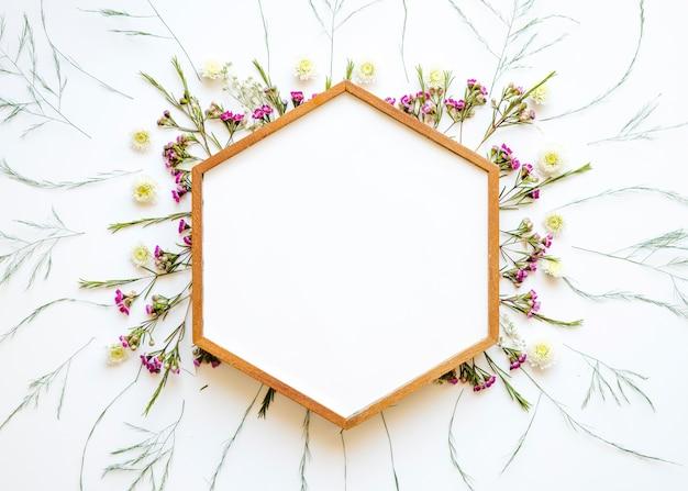 Hexagon frame on lovely wild flowers Free Photo