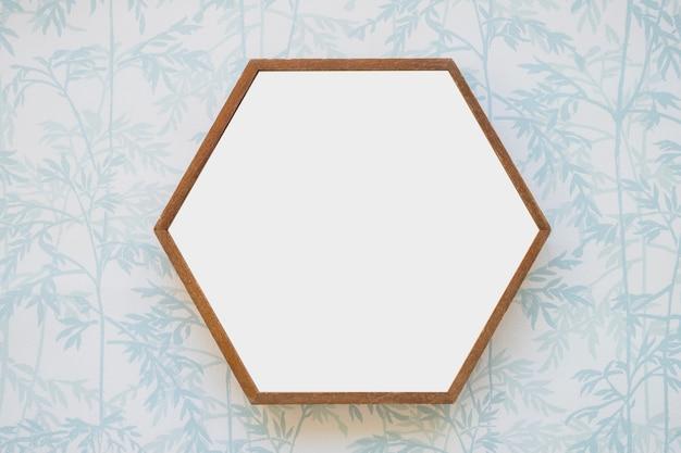 Hexagon white frame on wallpaper Free Photo