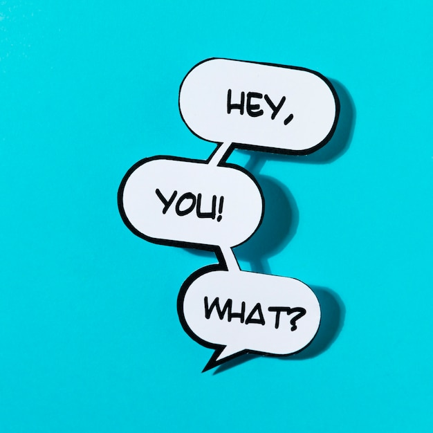 Hey you! exclamation word with shadow on blue background Free Photo