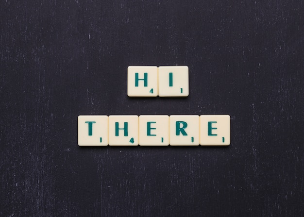 Hi there text arranged in a row over black background Free Photo