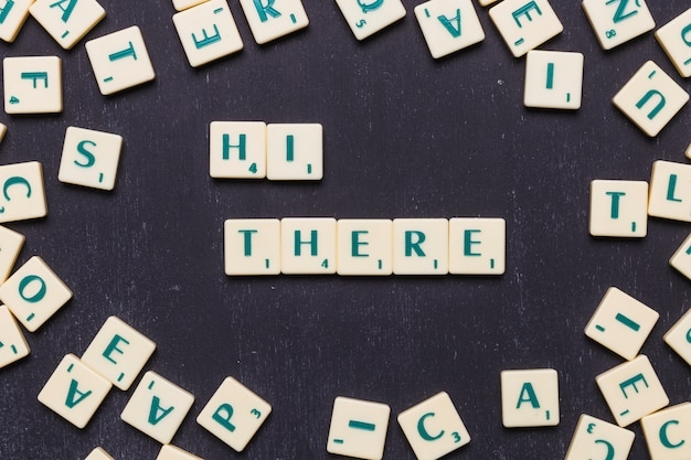 Hi there word arranged with scrabble letters Free Photo