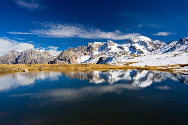 High altitude blue alpine lake in autumn season Premium Photo