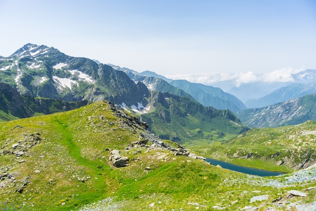 High altitude blue alpine lake in summertime Premium Photo