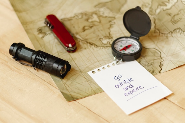 High angle adventurer kit with map and compass Free Photo