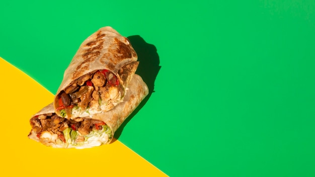 High angle arrangement with burrito and copy-space Free Photo