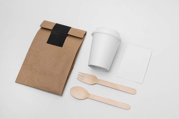 High angle arrangement with cup and paper bag Free Photo