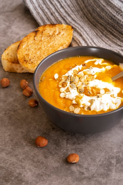 High angle arrangement with pumpkin soup and toast Free Photo
