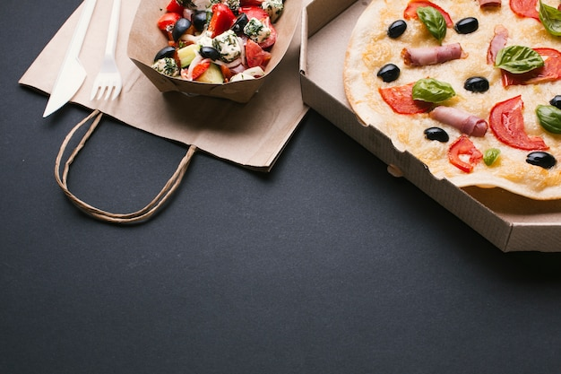 High angle arrangement with salad and pizza Free Photo