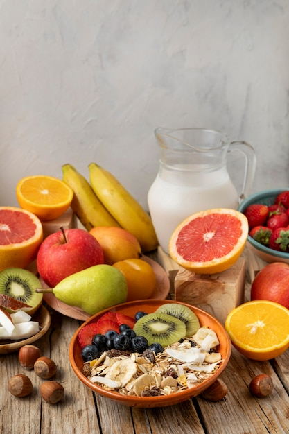 High angle of assortment of fruits with breakfast cereals and milk Premium Photo
