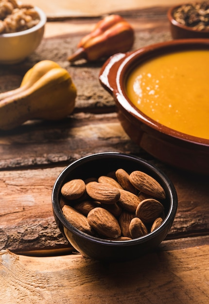 High angle assortment with almonds, soup and pumpkin Free Photo