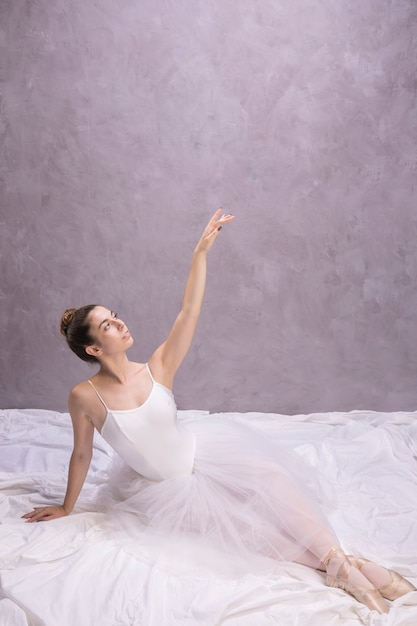 High angle ballerina looking away Free Photo