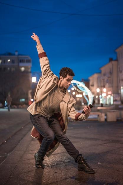 High angle ballet dancer performing at night Free Photo