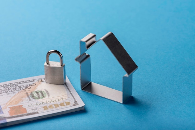 High angle of banknotes with lock and house Free Photo