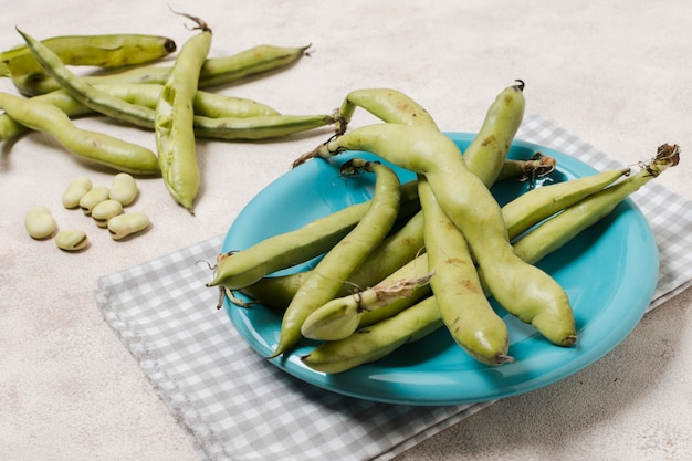High angle of beans on plate with garlic Free Photo