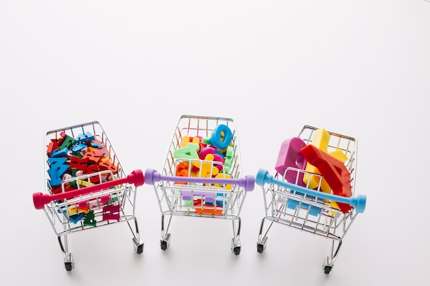 High angle black friday shopping carts Free Photo