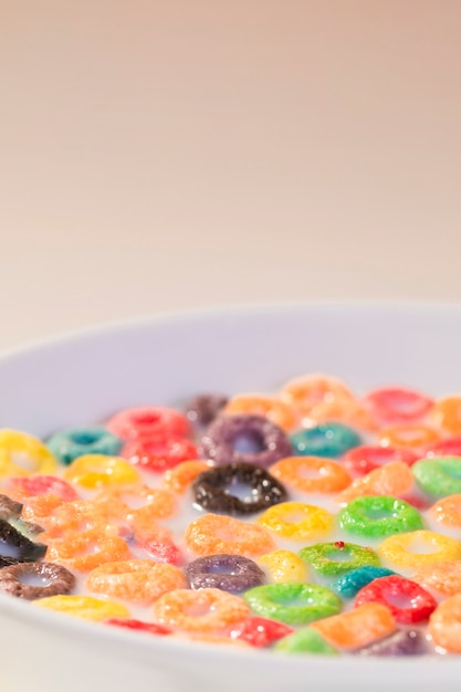 High angle bowl with milk and cereals Free Photo