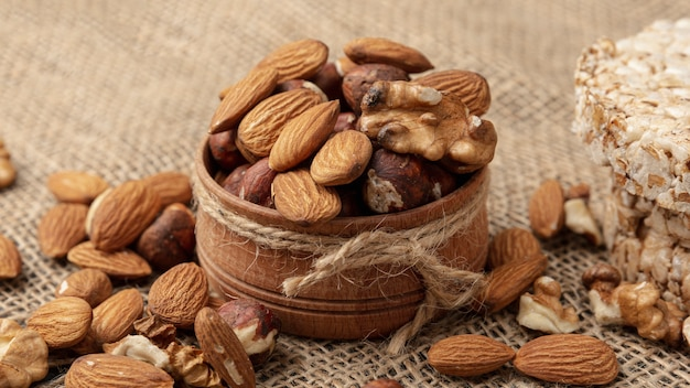 High angle of bowl with walnuts and other nuts Free Photo