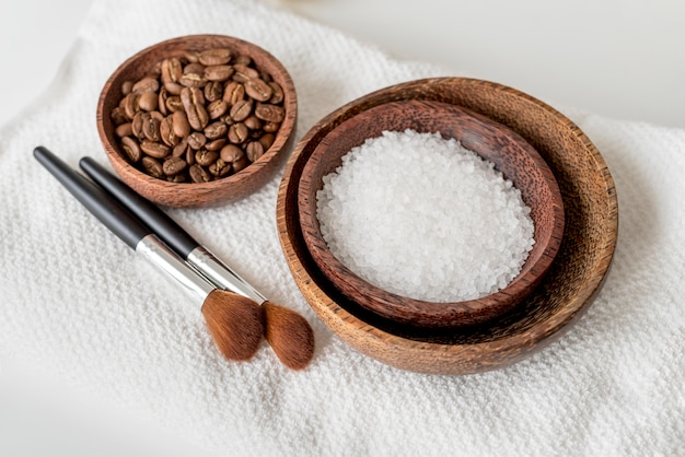 High angle bowls with salt and coffee beans Free Photo