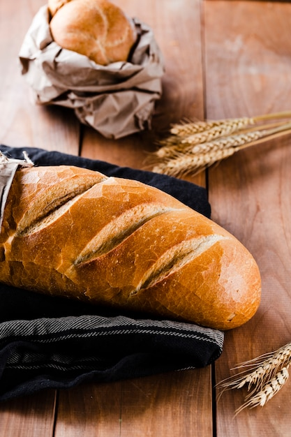 High angle of bread on wooden table Free Photo