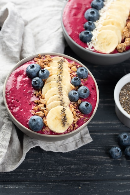High angle of breakfast desserts with blueberries and banana slices Free Photo
