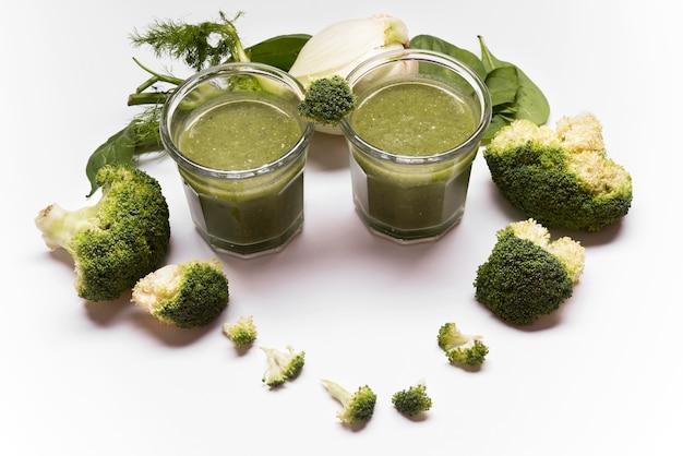 High angle broccoli smoothie assortment Premium Photo
