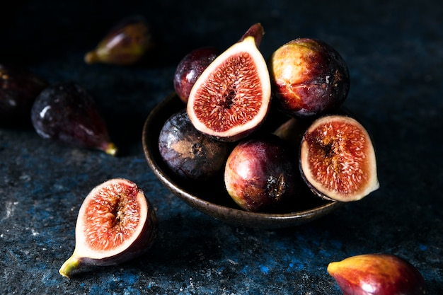 High angle of bunch of autumn figs on plate Free Photo
