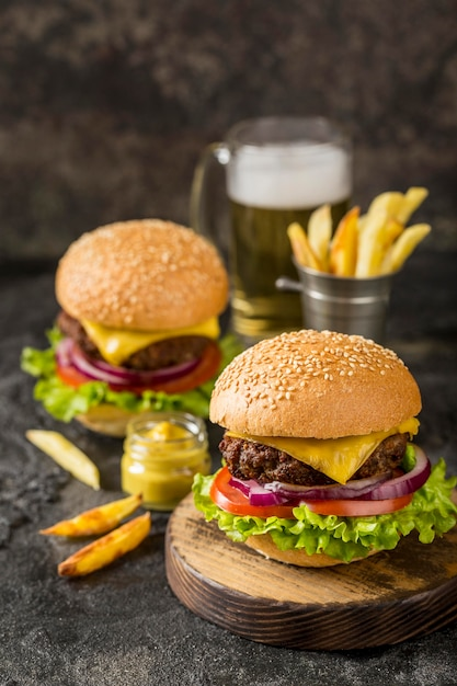 High angle burgers with fries, sauce and beer Free Photo