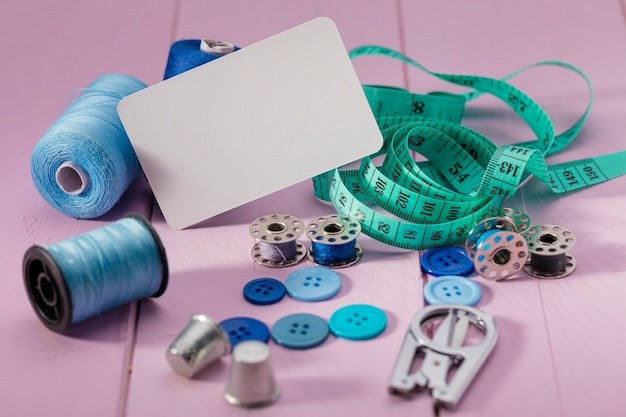 High angle of buttons with measuring tape thread reels Free Photo
