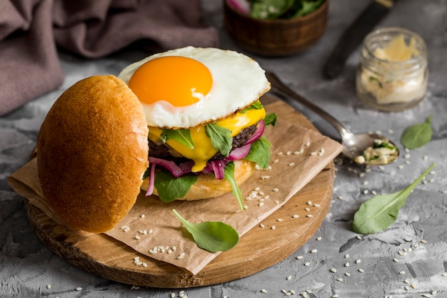 High angle cheeseburger with fried egg Free Photo