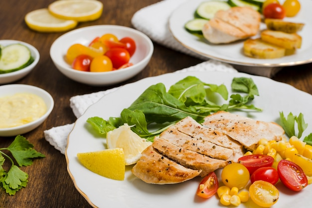High angle of chicken breast with variety of vegetables Free Photo
