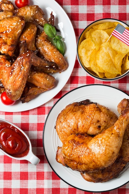 High angle chicken legs and wings with chips Free Photo
