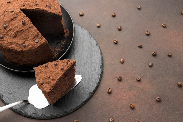 High angle of chocolate cake with coffee beans Free Photo