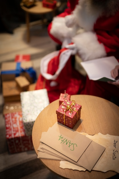 High angle christmas envelopes and gifts Free Photo