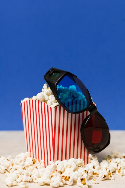 High angle cinema glasses and popcorn Free Photo