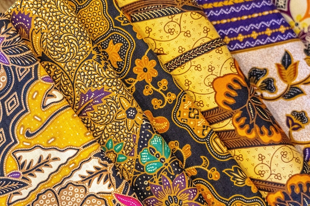 High angle closeup shot of colorful textiles with beautiful asian patterns Free Photo